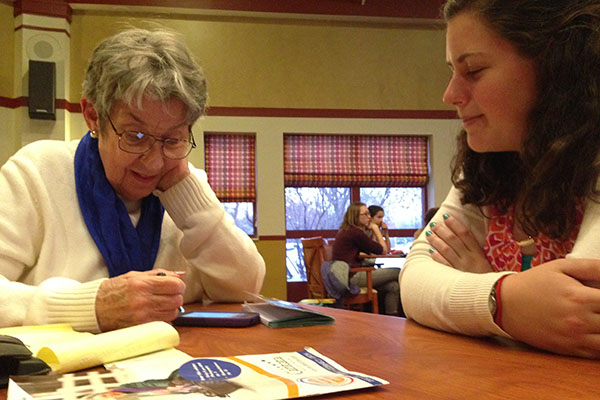 As a second time instructor, senior Claire Bartolone helps Shelia with her Nexus tablet.