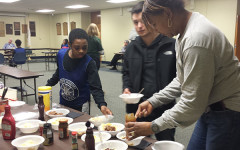 African American Cultural Association (AACA) sponsor Alison Jackson serves ice cream  to those who attended a  meeting with people who walked in Selma.