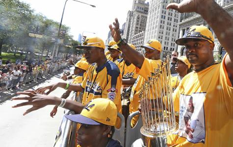 Jackie Robinson West coach Darold Butler and his players celebrate this summer after their US championship.  The team was recently stripped of its title after it was revealed that the team extended its boundaries to add players to its roster.
