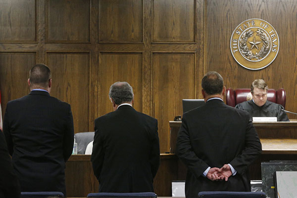 State District Judge Jason Cashon, right, reads the sentence of guilty at the capital murder trial of former Marine Cpl. Eddie Ray Routh, left, at the Erath County, Donald R. Jones Justice Center in Stephenville, Texas, on Tuesday, Feb. 24, 2015. Routh, 27, was convicted of the 2013 deaths of Chris Kyle and his friend Chad Littlefield at a shooting range near Glen Rose, Texas. (Michael Ainsworth/Dallas Morning News/TNS)
