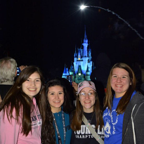 Mariel Sandoval, Selene Anaya, Isabelle Rogoz, and Ashley Lams pose in front of Cinderella's Castle.