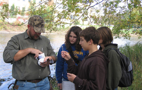 Biology teacher Jame Holt works with students in the early years of SEE team doing water quality testing.  Visit Clarion's interactive timeline to see other memories of the team.