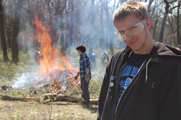 Day of Service students participate in a controlled prairie burn in 2014.  Event organizers hope to build off of last year's success.