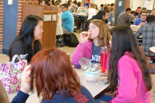 Seniors Grace Rasmussen, Ashley Lams, and Parley Belsey (from left) eat lunch.