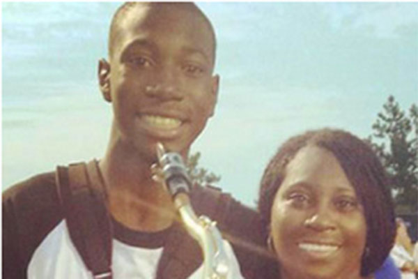 Bryan Wilson poses with his beloved saxophone and his mother.