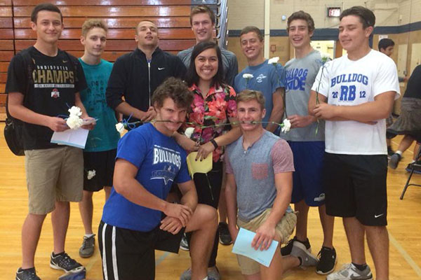 The top 10 nominees for boys homecoming court stand with nominee Silvana Alvarez.