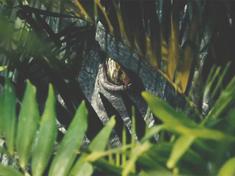 Indominus+Rex+looks+through+the+foliage.