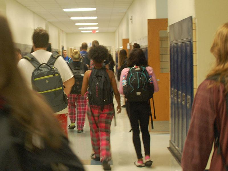Students walk the halls in their pajamas for Monday's pajama theme.