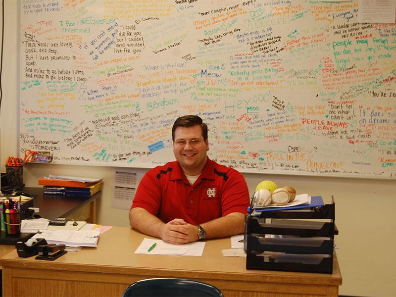 Mr. Boyd at his desk.