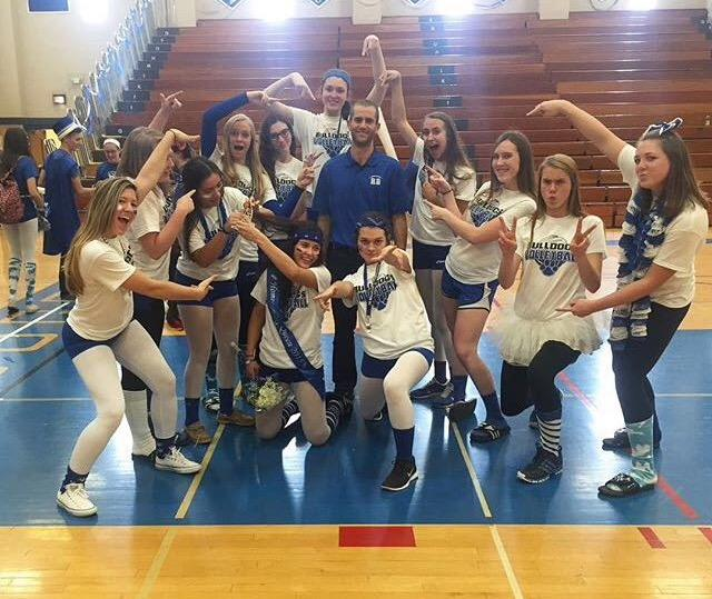The+girls+varsity+volleyball+team+poses+for+a+team+photo+after+the+pep+rally.+