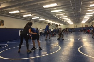 Girl wrestlers at practice.