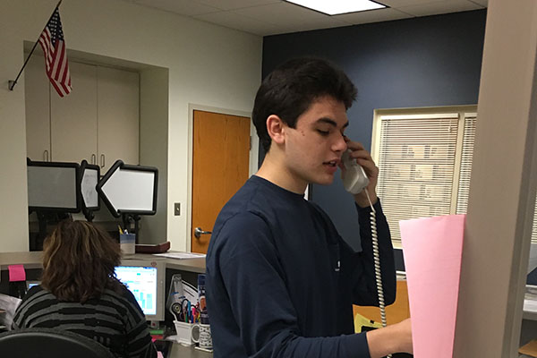 Senior Tom Loftus reading the morning announcements.