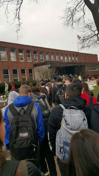 Students re-enter RBHS after a brief evacuation on Friday, January 15, 2016.