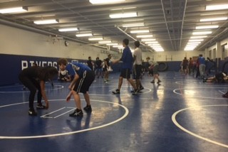 Wrestling practices their techniques.