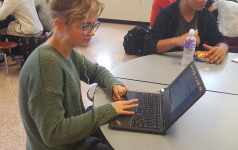 Sophomore, Sophia Doty, working on homework on her chromebook during lunch.