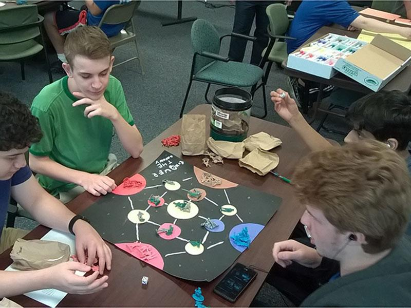 Contestants playing a board student-designed game.