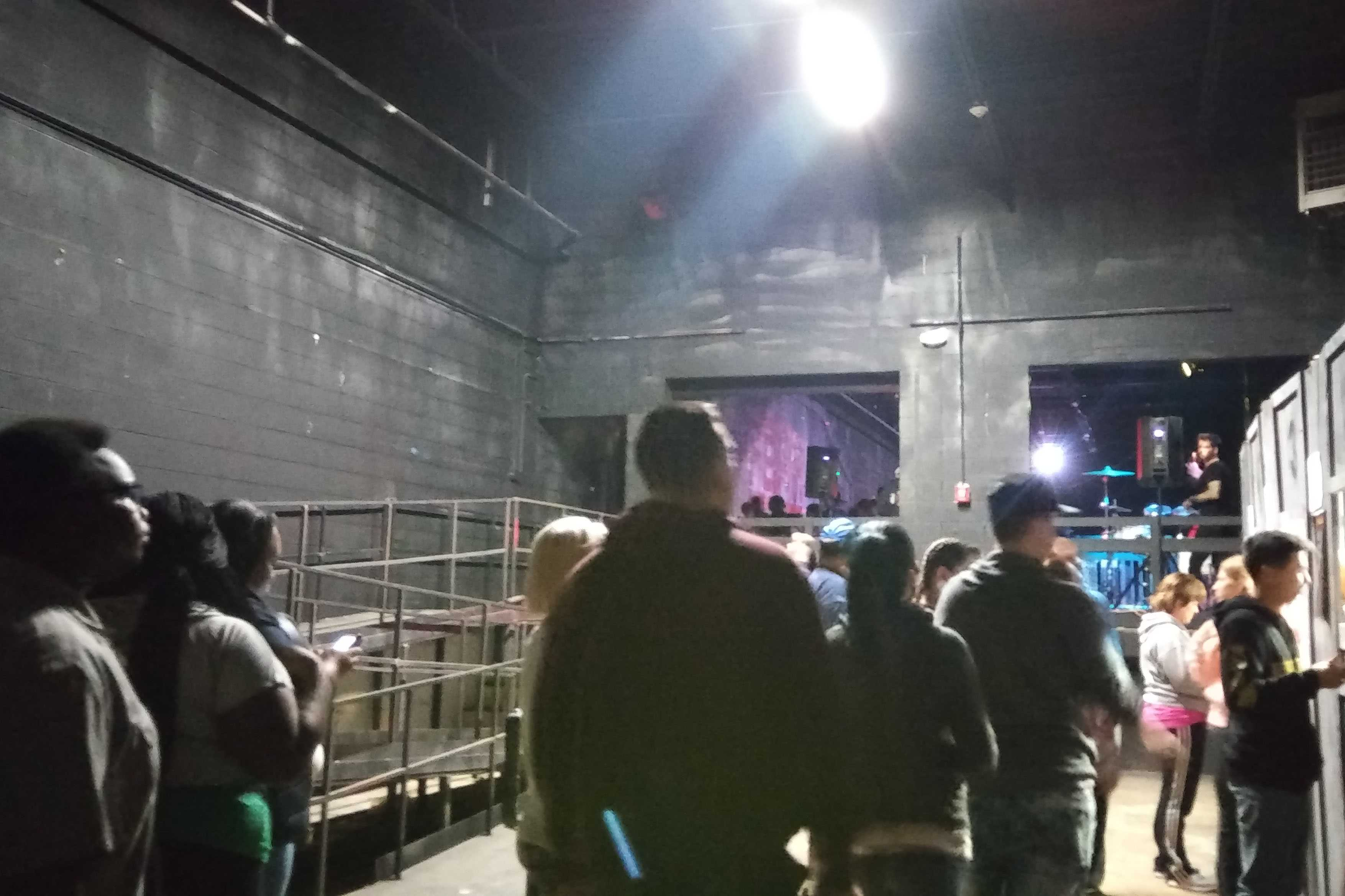 People waiting outside Midnight Terror Haunted House