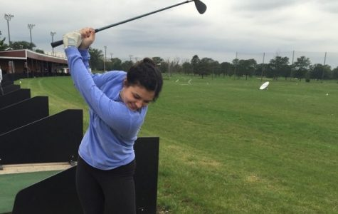 Senior Coco Murray practices her swing on a driving range.