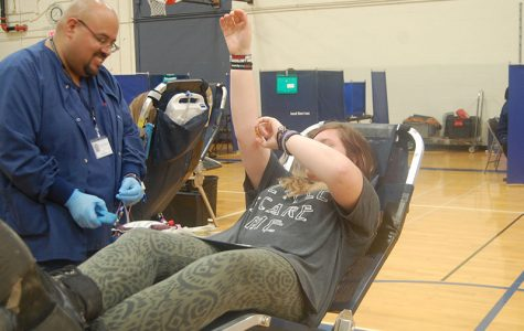 A student raises her arm to avoid fainting during a previous RBHS blood drive in November 2016.