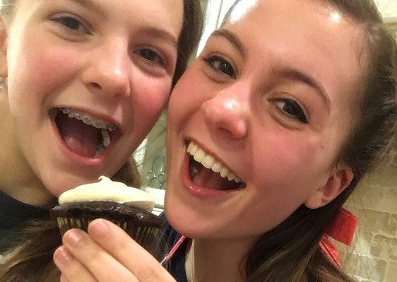 Mazzy and Ivy Marcucci with one of their cupcakes