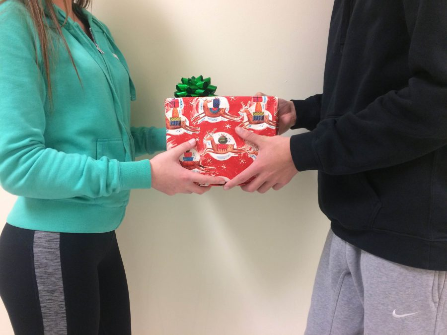 Two+RBHS+students+exchanging+gifts.