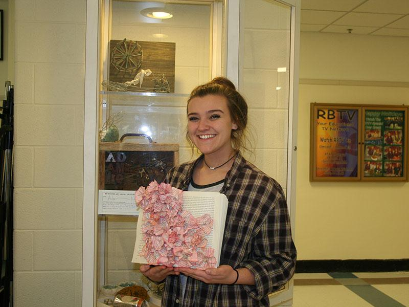 """I would just say life, life inspired it. No [color scheme]. This one symbolizes like when you're reading it can come to life, like books can come to life. The book took like two weeks. I ripped the pages out of the book and then crumpled them together to make flowers,""  said sophomore Daiva Walz"