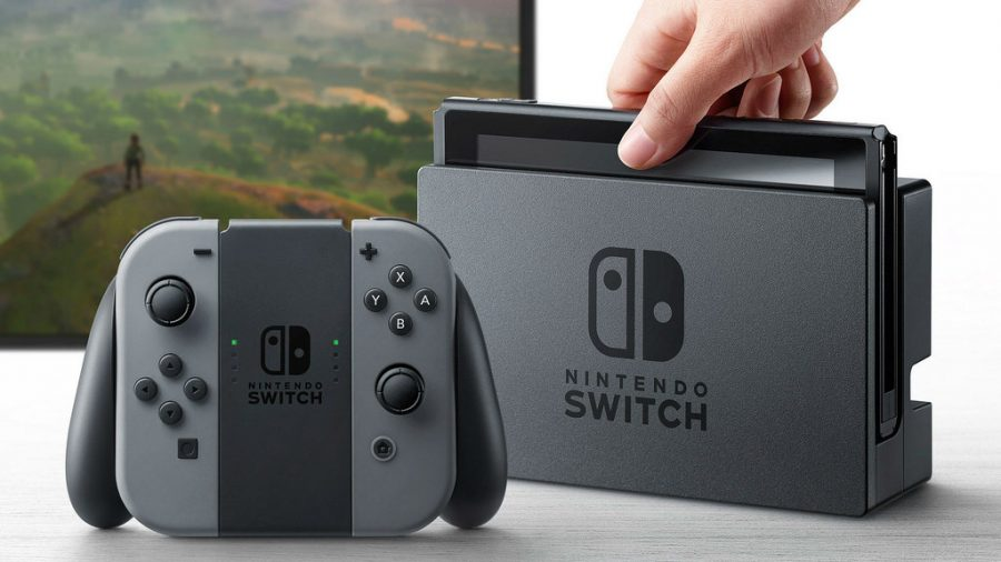 The Nintendo Switch when it is docked, with the Joy-Cons in the Joy-Con Grip. Playing in the background is The Legend of Zelda: Breath of the Wild.