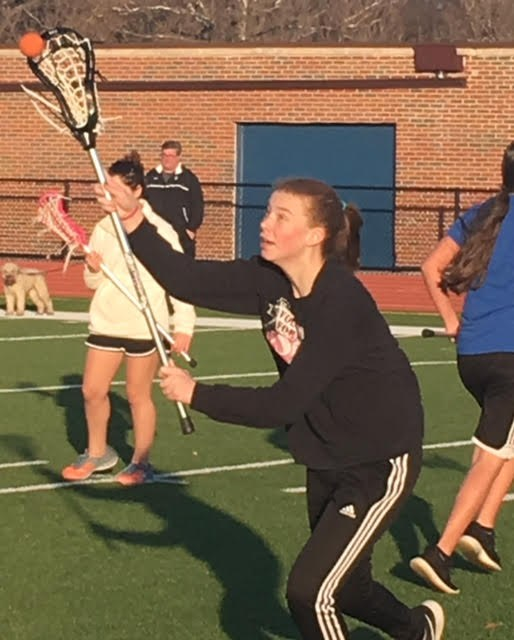 Erin Parcel playing Lacrosse