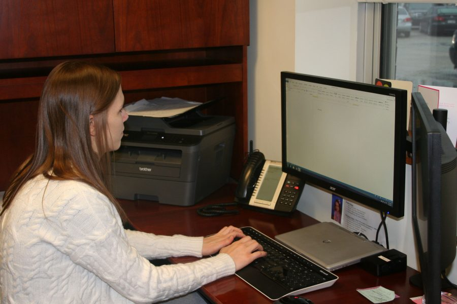 Principal Kristin Smetana working at her computer.