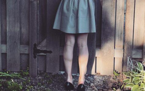 A student wearing a short skirt, violating school dress code.