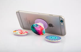 iPhone being held up by a PopSocket