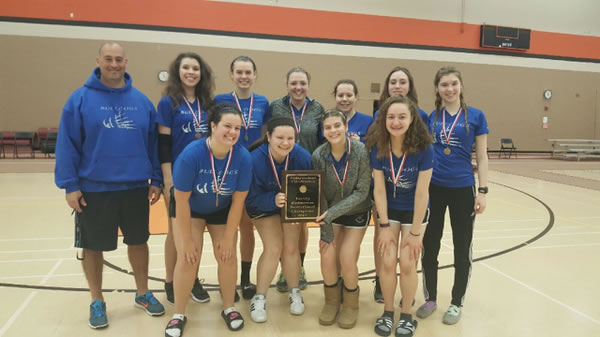 Girls pose after winning conference