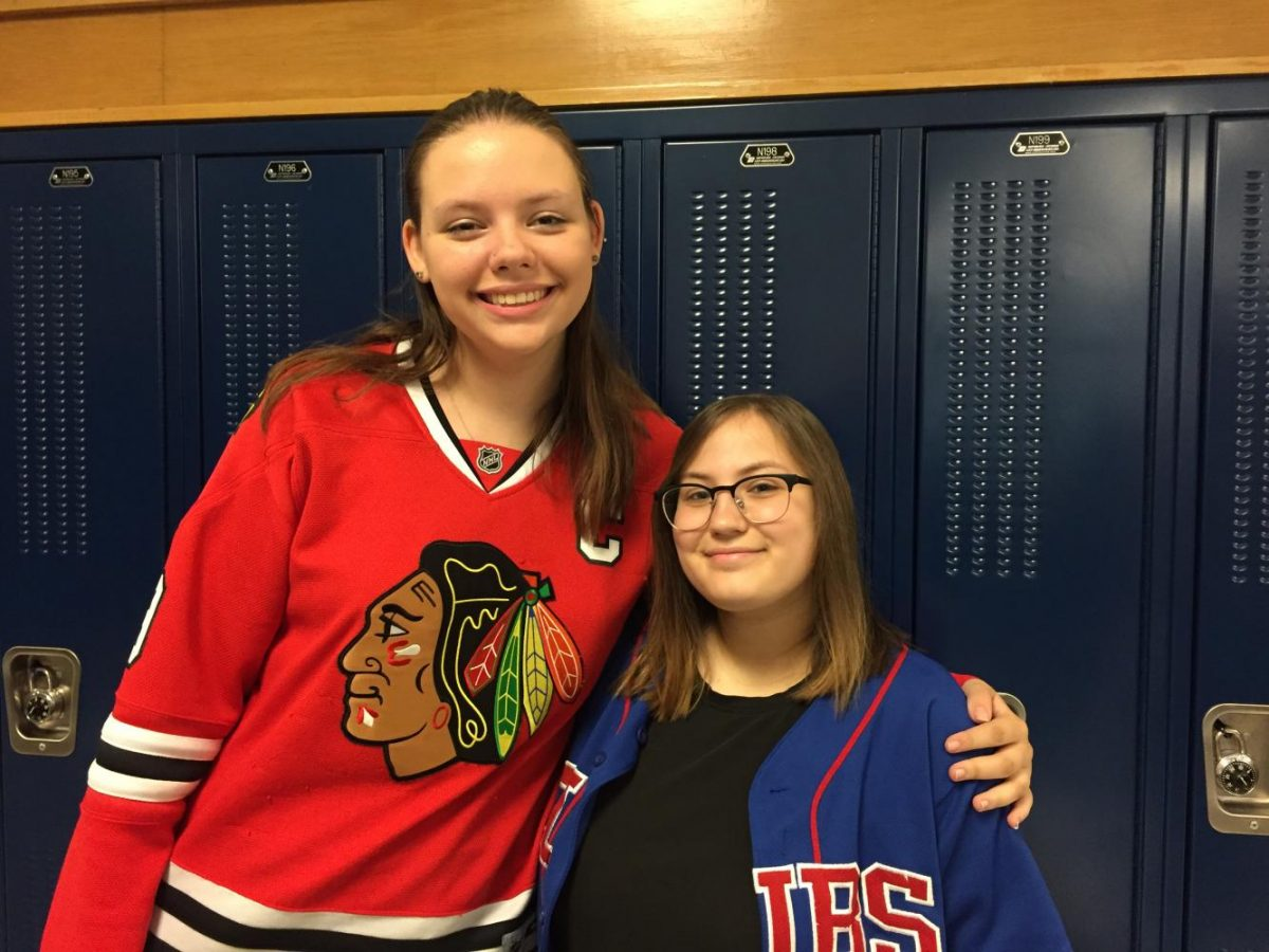 Students Francesca Perry and Delaney O'brien show school spirit on jersey day.