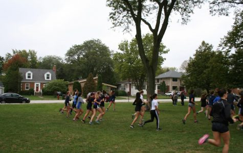 The RBHS girls cross country team practices before their upcoming conference meet.