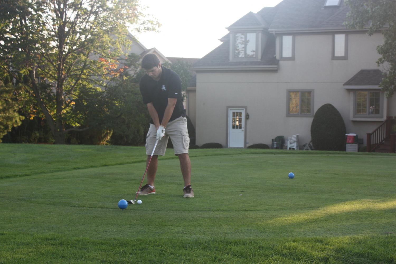 Chris Robertson at the tee box lining up his shot.