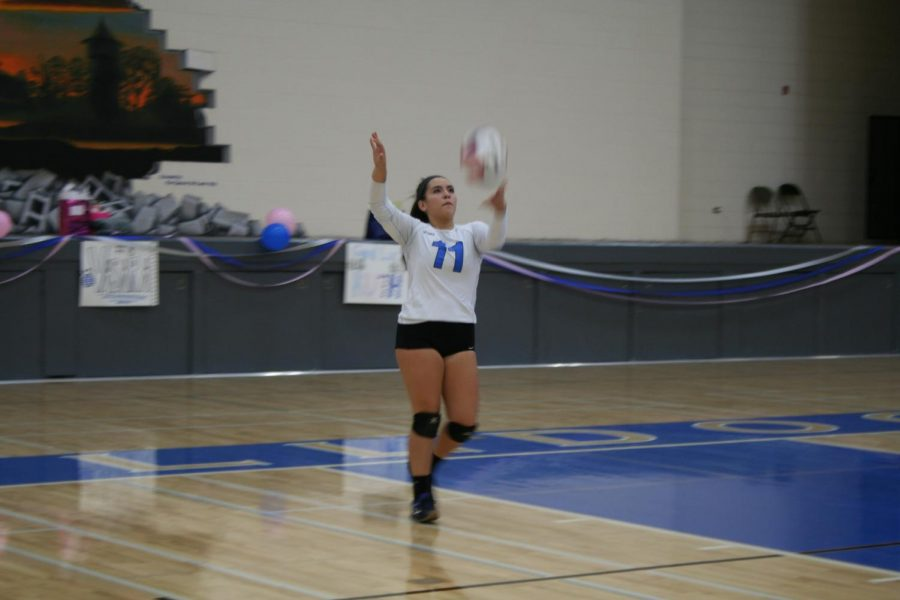 Senior, Maya Diaz serving in the Senior Night game.