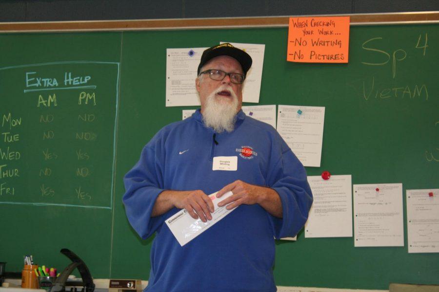 Veteran talks to a group of high school seniors.