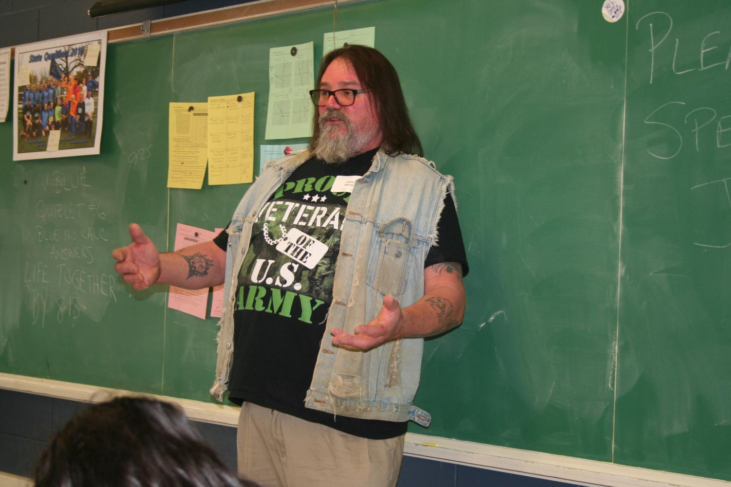 John Perry talking to students, room 210.