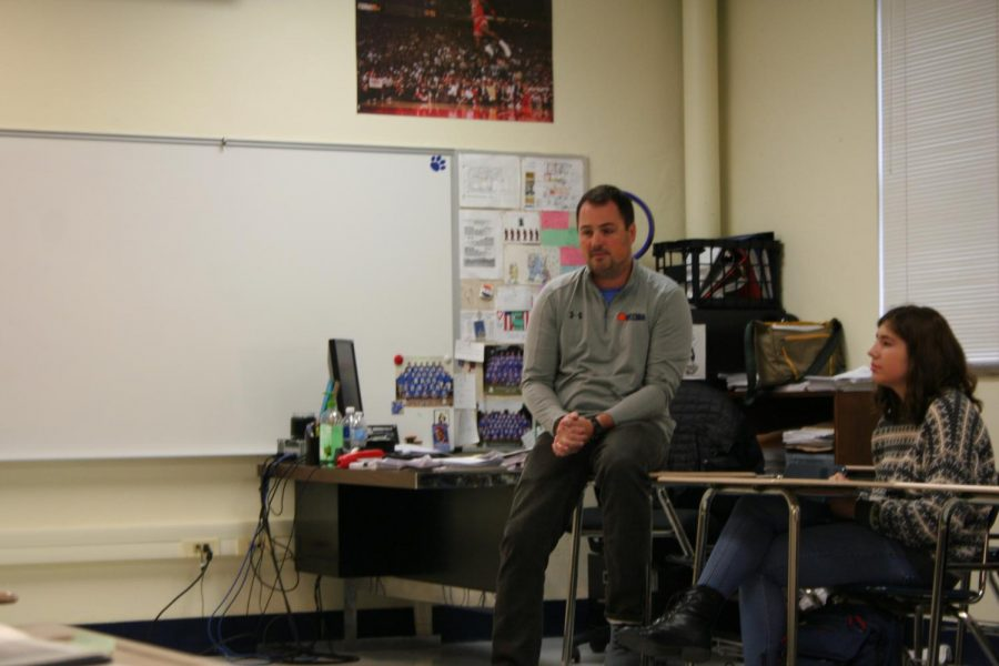 Kevin Turk talking to students in room 243.
