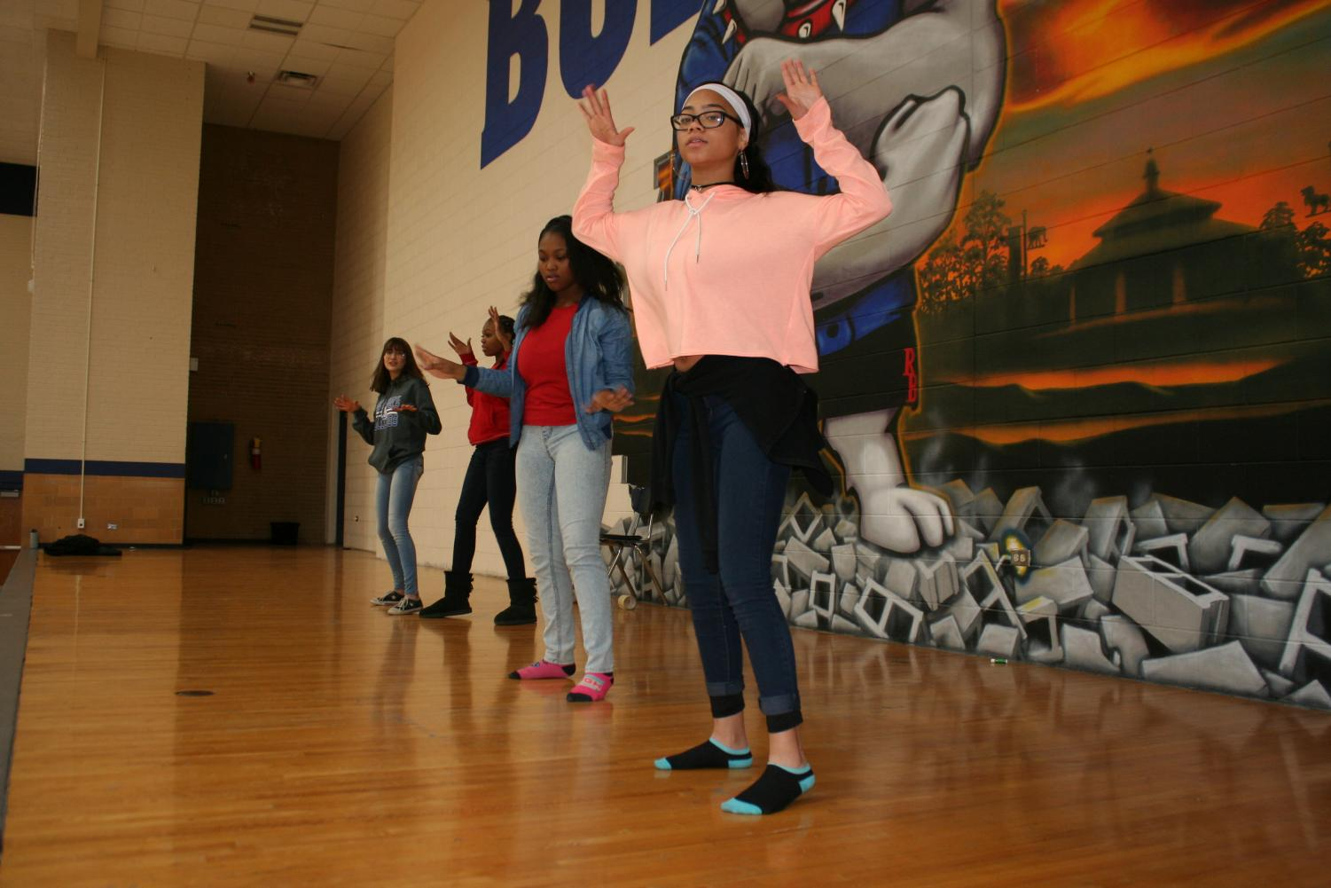 Students practicing for new hip-hop group