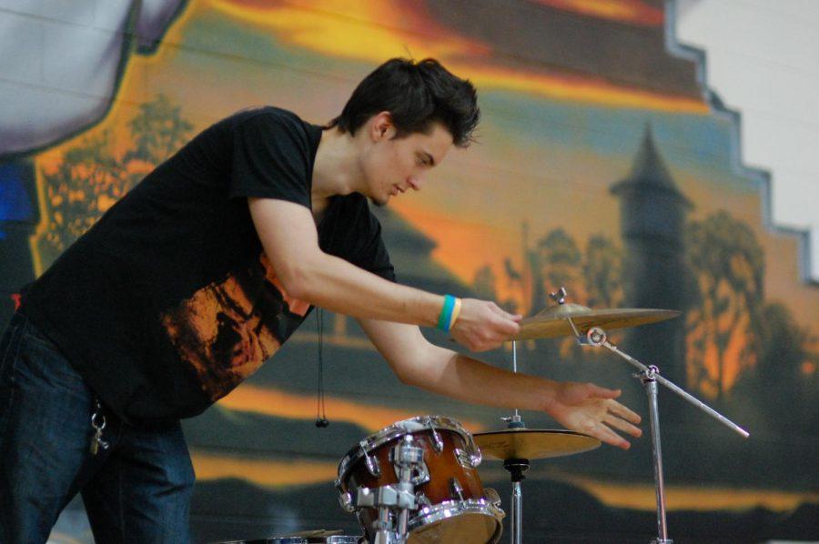 Senior Joe Angeloni sets up drums before the game