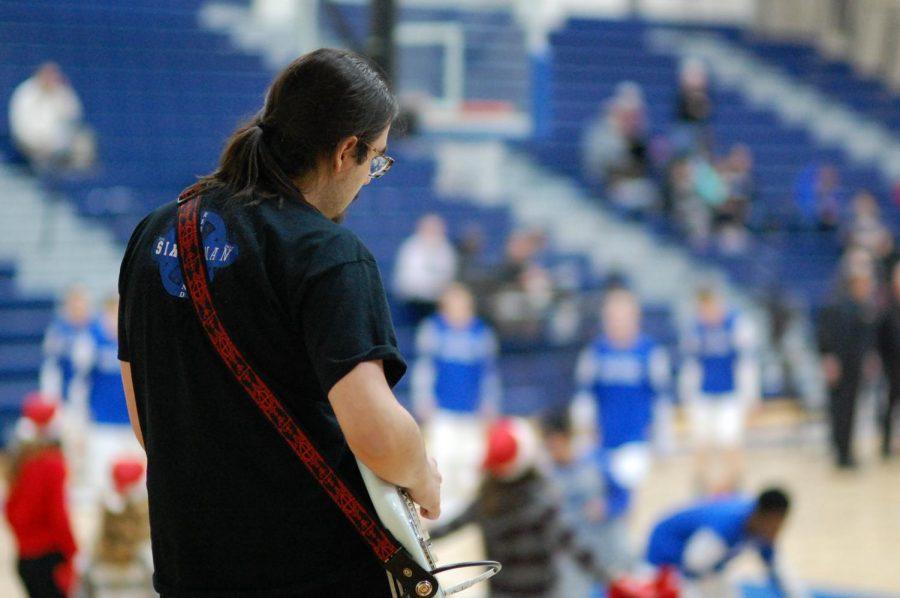 Junior Evan Moyer plays during pre-game warmups