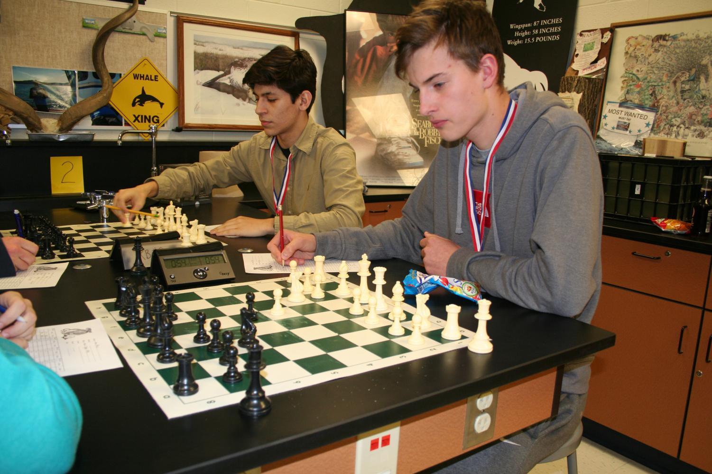 Senior Juan Quiroz and sophomore Rokas Lukosevicius scrimmaging during practice.