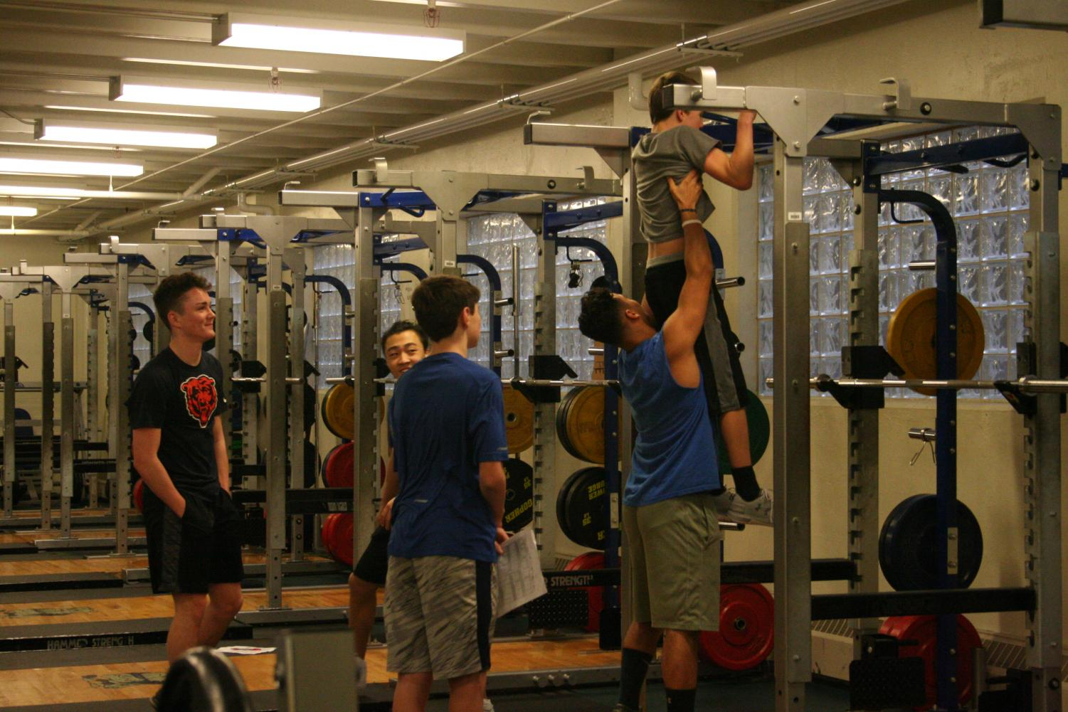 Football players supporting one another during the Commitment Challenge.