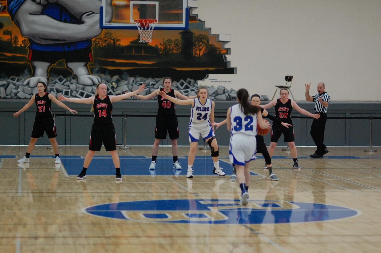 RB girls' basketball players playing Glenbard East.
