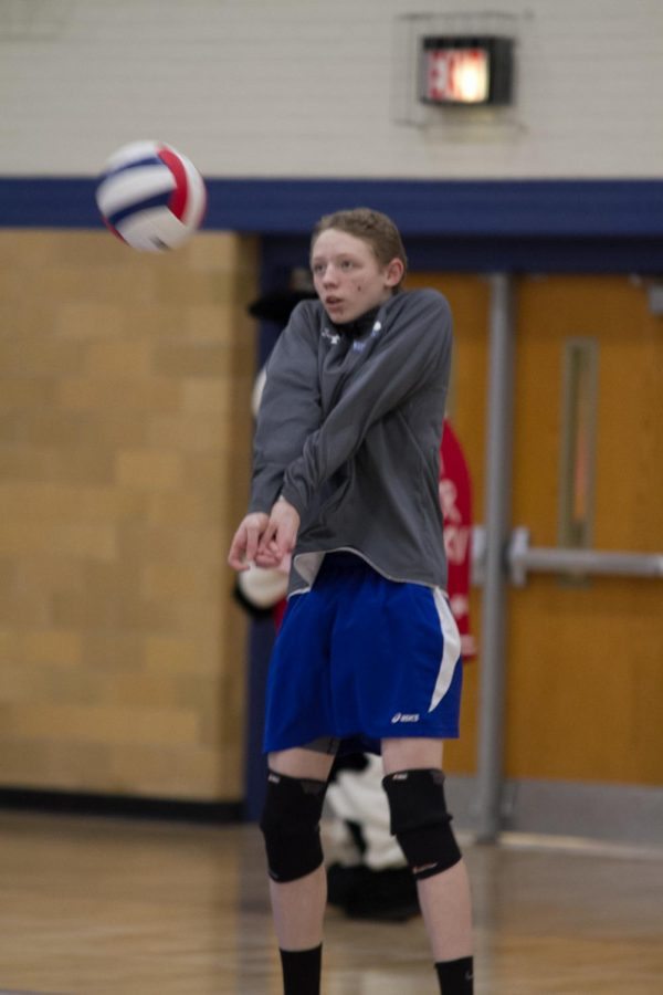 DJ Degand passing a volleyball in warmups vs. Morton