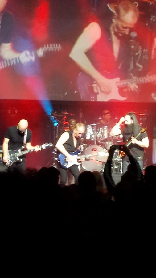 Joe Satriani, John Petrucci, and Phil Collen jamming on stage.