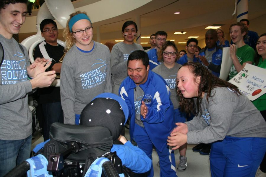 RB Special Olympics basketball team celebrates with the student body during their send off early Friday morning.