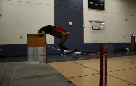 Devin Moody practices high jump.