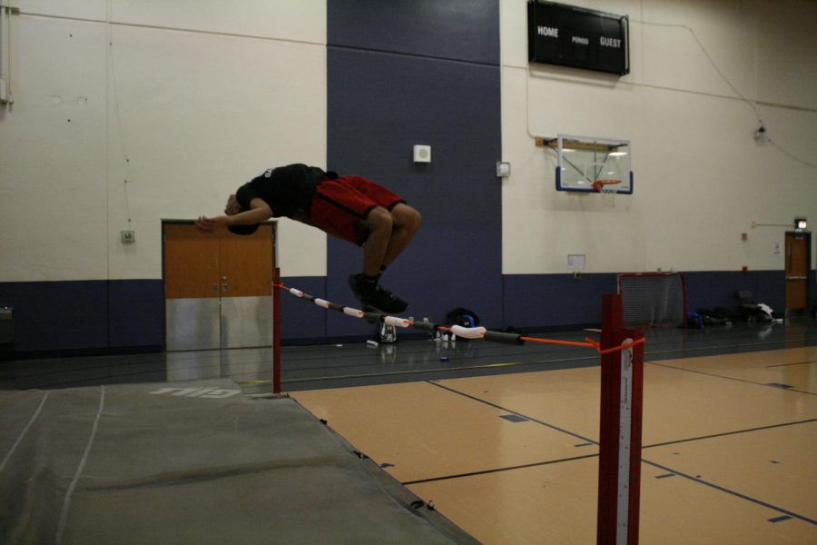 Devin+Moody+practices+high+jump.